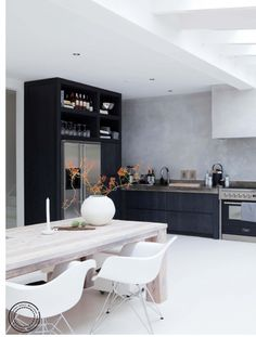 Good combo: white floor, black kitchen, rustic table, modern chairs.