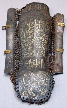Ottoman Empire calligraphic ornament on mail and plate kolçak aka greaves or shin armor worn by fully armored cavalrymen or sipahi. Museums often confuse kolçak (greaves) for kolluk/bazu band or arm guards. Helmet Armor, Arm Armor, Ancient Armor, Medieval Armor, Armor Clothing, Empire Clothing, Ottoman Turks, Knight Armor, Ottoman Empire