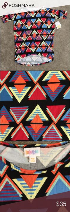 LuLaRoe BNWT geometric print Irma black Gorgeous BNWT Lularoe Irma tunic. Such amazing, bright vivid colors! Black background with triangle design. This material is very stretchy. Remember this shirt runs big! An XXS will fit a normal XS/S. LuLaRoe Tops