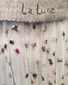 Dior Avenue Montaigne. Dior up close, via Cécile Narinx, Editor in Chief, Harper's Bazaar Netherlands. Insect & bees embroidery details.