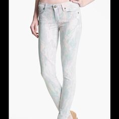"""HPNWOT Paige Verdugo Candy Print Skinny Jean These jeans are NWOT! They are a size 25, but run a full size small. They would better fit a size 24. These jeans are light pink with purple and light blue splashes of color all over them. They are approximately 13"""" across the waist when laid flat. They are approximately 37"""" long with a 28"""" inseam. They are 98% cotton, 2% elastane. PLEASE USE MEASUREMENTS First photo credit nordstrom.com. Paige Jeans Jeans Skinny"""