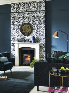 In this living room, white highlights the chimney breast and fireplace, making them the stars of the show. The speckled feature wall complements the navy blue walls to create a cosy setting, whilst the copper floor lamp adds a contemporary touch. Blue And Copper Living Room, Navy Living Rooms, Living Room Green, My Living Room, Blue Feature Wall Living Room, Feature Wallpaper Living Room, Cosy Living Room Decor, Navy And White Living Room, Feature Walls