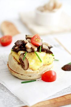 creamy scrambled eggs, fresh shiitake mushrooms sauteed in garlic & butter on toasted english muffin. garnished with snipped chives, freshly cracked black pepper & cherry tomatoes.