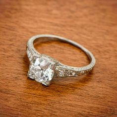 A fantastic rare one-of-a-kind antique platinum engagement ring, set with a beautiful old European cut diamond!