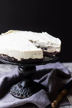 This Paleo Cheesecake layered with chocolate chip cookie dough and brownies is the ultimate special occasion dessert.