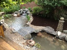 Beautiful pond and brick bridge installed in Oak Park, IL by Gem Ponds.