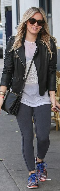 Black leather jacket, orange print sneakers, and handbag .........................................