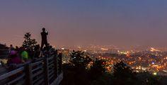 Photographer Above the Seoul Skyline