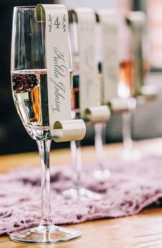 This is a really sweet idea for escort cards: put your guests' names & table number on a champagne glass!
