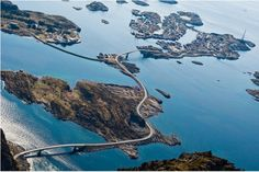 The Atlantic Road, Norway. It is built on several small islands and skerries, which are connected by several causeways, viaducts and eight bridges—the most prominent being Storseisundet Bridge.