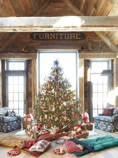 "Waiting for Santa - Kids will love this idea: Add cozy sleeping bags for ""campouts"" under the Christmas tree."