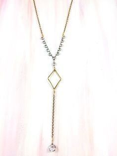 """""""Fully Present"""" - 1930's delicate rhinestone chain paired with a geometric brass medallion on antique brass chain"""