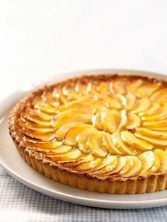 French Apple Tart Recipe With Pastry Cream Recipe A classic French dessert you can make at home. Apple slices are baked on a layer of pastry cream in a sweet shell, then garnished with apricot glaze. Köstliche Desserts, Delicious Desserts, Dessert Recipes, Plated Desserts, Sweet Pastries, French Pastries, Apple Recipes, Sweet Recipes, French Recipes
