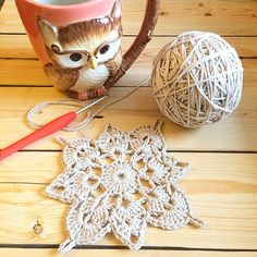 A cup of coffee a #crochetneedle and a ball of #yarn goes hand in hand. #CoffeeCupCollector #lovetocrochet #crochetmotif #crochet #ballofyarn