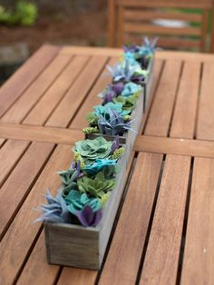 Create this vertical succulent garden to decorate an artistic entrance wall. These foam blocks provided the perfect starting point to create a felt succulent vertical garden for that space. You can craft them from paper for vertical placement.