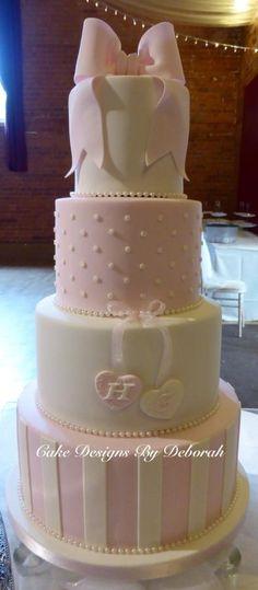 Pretty Pink  Ivory Wedding Cake   https://www.facebook.com/CakeDesignsByDeborah