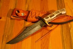 Colt CT0408 Alamo Bowie Damascus, Stag Handle, Brown Leather Sheath. http://www.osograndeknives.com/store/catalog/fixed-blade-damascus-knives/colt-ct0408-alamo-bowie-damascus-stag-handle-brown-leather-sheath-13155.html