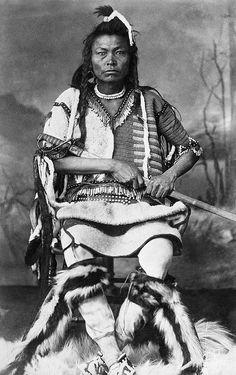 Title: Blackfoot warrior with sword. Date: [ca. 1887] Photographer/Illustrator: Ross, Alexander J., Calgary, Alberta.
