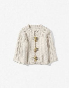 You can never go wrong with a neutral cable knit in our book! Baby Sweater by Zara.