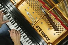 A Model D piano being tuned at the Steinway Piano factory in Astoria, Queens.