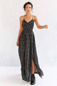 Bathing suit cover ups that will take you from beach to party all Summer long: Ecote strappy black safari maxi dress ($98)