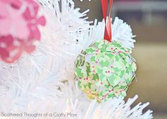 Paper Flower Christmas Tree Ornament Craft for Kids: If you have little kids, you know they love paper crafting and poking pins into anything. Why not combine the two for the perfect, most fun ever, Christmas tree ornament craft!