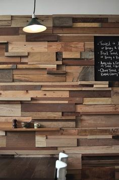 Recycled wood block wall. A bit too irregular, still looking for a pic of a wall made with flat or angled square blocks.