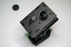 Raspberry Pi Camera Case With Wall And Ceiling Mount - The Raspberry Pi camera case bundle includes a specially designed black matte Raspberry Pi case to protect your system, together with a magnetic fish-eye lens giving the Raspberry Pi Camera module a 180 degree viewing angle.   Geeky Gadgets