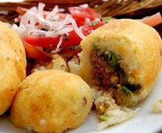 """Potato Balls"". Mashed potato balls filled with ground beef and lightly fried."