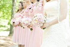 Pretty bridesmaids and their flowers