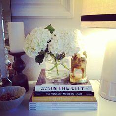 books, gardenias in a mason jar, candle