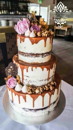 Wedding cake - Salted Caramel mud cake with salted caramel sauce, salted caramel buttercream. Red Velvet tier with cream cheese frosting. Handmade Dahlias, meringues, caramel popcorn, chocolate Bark and honey comb.