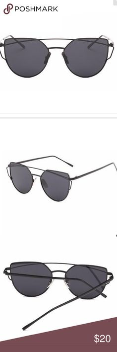 Flat Lens Mirrored Cat Eye Sunglasses Black/Black Metal frames with an oversized cat eye lens. Black lens with black frames. Resin and metal. UV400. Total width 143mm. Lens width 57mm. Frame height 52mm. Bridge 18mm. Leg length 140mm. Boutique Accessories Glasses