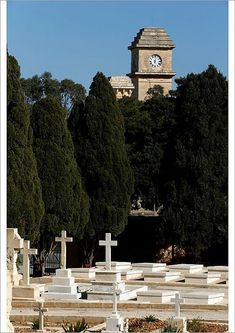 Poster-The Saint Patrick& Barracks clock tower is seen from the Pembroke Military Cemetery poster sized print mm) made in Australi Artwork Prints, Poster Size Prints, Framed Prints, Military Cemetery, Photo Archive, Perfect Photo, Photographic Prints, Saint Patricks, Gifts In A Mug