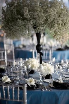 budget friendly idea? These gorgeous centerpieces made from gypsophila, baby's breath has always played a small supporting roll for its more colorful cousins. But take one seemingly common flower in multitude and the ordinary becomes extraordinary.