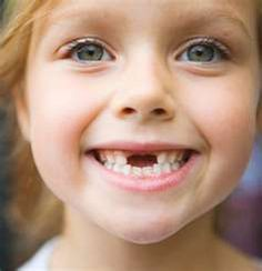 """when i was five i lost my first two front teeth.My mom didn't tell me to put my teeth underneath my pillow and wait for the """"tooth fairy"""", instead she told me to throw them in the garden and they will grow back, like plants do. This was in June 2006"""