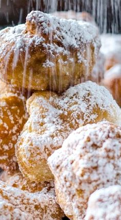 Zeppoles - Balls of dough are quickly fried so they beautifully puff up and then immediately get dusted with powdered sugar. ❊