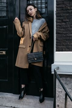 12ee0121 The Ultimate Classics tailored masculine camel coat with pointed boots and  Chanel 2.55 flap bag editorial