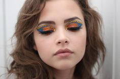 Crystal lined eye lids accent blue and orange eye shadow inspired by 'Rio'.