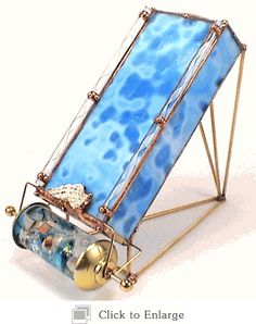 Stained glass kaleidoscope by Sue Rioux - looks like a treasure from the sea! http://www.kaleidoscopestoyou.com/stained-glass-kaleidoscopes-sue-rioux-blue-lagoon.html