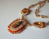 Agates Des.   Orange and cream soutache necklace