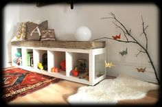 montessori-inspired baby-height shelves and toys + love the colorful rug and sheepskin