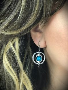 Handmade silver tone earrings with 8mm aqua shell stone center Fish hook backing Dangling center