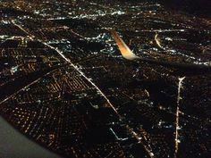 Bright city lights on the way to Vietnam.