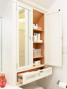 Found storage space :: Extended counter and cabinetry over the bathroom toilet alcove.