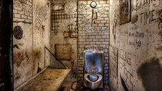 [UNVERIFIED CONTENT] Moundsville West Virginia, West Virginia State Penitentiary Cell Block with Graffiti and drawings on the Cell Block walls showing life inside the Penitentiary and State Prison Cell