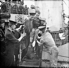 Disembarkation of wounded troops during Operation JUBILEE, the raid on Dieppe. / Débarquement de soldats blessés lors de lopération « Jubilee », le raid sur Dieppe by BiblioArchives / LibraryArchives, via Flickr