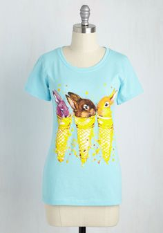 What's this? A graphic tee that's cute enough to eat? Well, we don't suggest munching on this cotton-blend top, but we highly recommend acquiring a taste for its bright aqua hue, yellow paint splatters, and precious critters chillin' in cones!