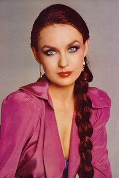 "Crystal Gayle, born 1951, is an American country music singer best known for her 1977 country-pop hit, ""Don't It Make My Brown Eyes Blue"
