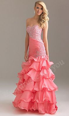 Prom dresses Prom dresses pink dress ruffles on the bottom drop waist dress bling on the top. Wow all it need is something for the sholders.